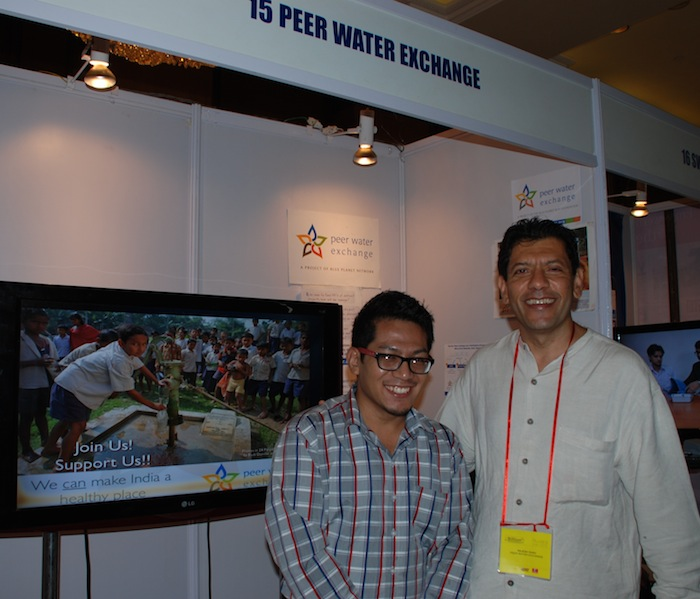 Rajesh Shah and volunteer Bharat at the PWX booth